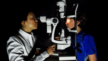 Maxime Jalbert-Locke, right, has an eye examination conducted by Dr Pauline Kang.