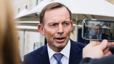 Former prime minister Tony Abbott on the hustings in Tasmania.