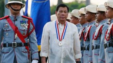 Philippine President Rodrigo Duterte, centre, said his war on drugs will continue for his entire term.