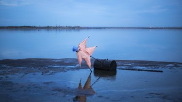 A scarecrow set up in a tailings pond created by oil sands processing north of Fort McMurray, Alberta.