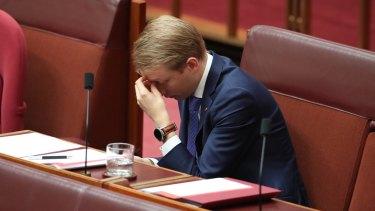 Senator James Paterson takes a moment in the Senate.