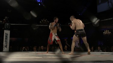 Mixed martial arts fighters battle it out in an Australian Fighting Championship event in Flemington.