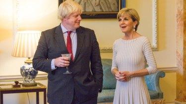 Boris Johnson listens as Julie Bishop speaks at 10 Downing Street on Thursday.