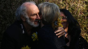 Jerzy Dyczynski, father of MH17 victim Fatima Dyczynski, is hugged by Foreign Minister Julie Bishop at the National Memorial Service in July.