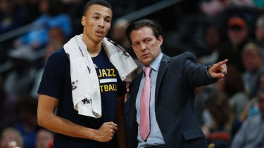 Australian guard Dante Exum receives instruction from Utah Jazz head coach Quin Snyder.