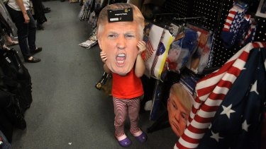 Alina Fisk, 4, poses with a Donald Trump cut-out while Halloween costume shopping with her mother in Florida.
