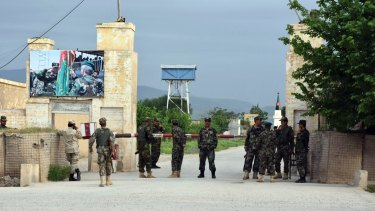 Afghan soldiers stand guard at the gate of a military compound after an attack by gunmen in Mazar-i-Sharif, north of Kabul, on Friday.