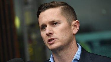AWU national secretary Daniel Walton speaks to the media following the raids on Tuesday.