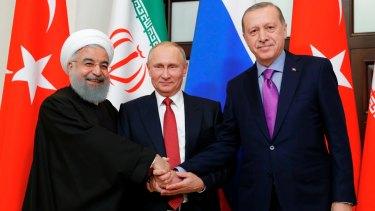 Growing friendship: from left, Iranian Hassan Rouhani, Russian President Vladimir Putin and Turkish President Recep Tayyip Erdogan in talks in Russia last month.