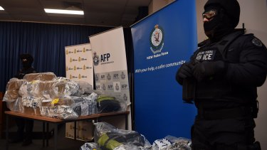 AFP officers stand guard over some of the cocaine seized during the Christmas Day drug bust.