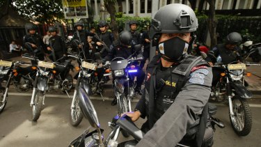 Indonesian Police arrive to search for suspicious materials as they anticipate terror attacks prior to the Christmas Eve mass at the Cathedral in Jakarta.