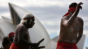 Dancers from the Koomurri perform on Sydney Harbour to promote Australia Day festivities.