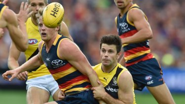 Rory Sloane and Trent Cotchin will play pivotal roles when Adelaide meets Richmond in the grand final.