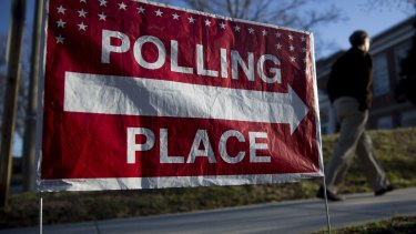"""A """"Polling Place"""" sign stands outside the Madison Activities Centre polling location in Arlington, Virginia."""