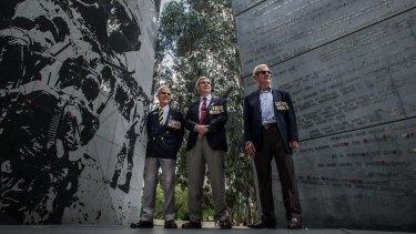Three of Canberra's Vietnam veterans meet at the Vietnam War memorial. From left: Jack Aaron, Peter Dinham and Greg Kennett.
