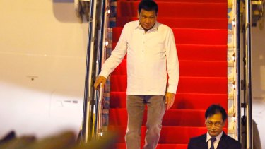 Philippine President Rodrigo Duterte steps down the plane as he embarks on his first foreign trip to Vientiane, Laos.