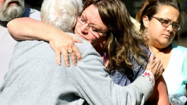 Friends and family are reunited with students after the shooting.