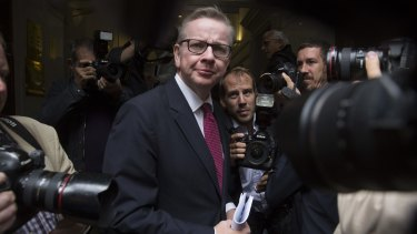 Michael Gove, UK justice secretary, is surrounded by photographers as he arrives for a news conference to announce his Conservative party leadership bid in London on Friday.