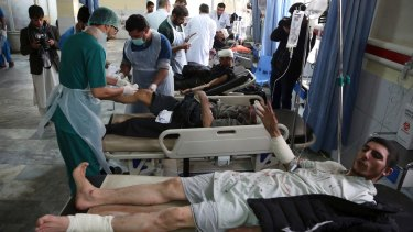 Injured men receive treatment after the attack in Kabul.