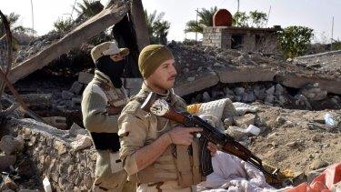 Iraqi soldiers advance in northern Ramadi,  115 kilometres west of Baghdad in the Sunni heartland of Anbar province.