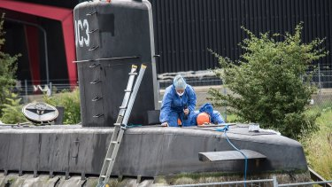 Police technicians scan the submarine where Swedish journalist Kim Wall was allegedly killed.