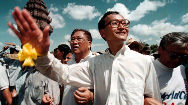 A younger Sam Rainsy leads an anti-government rally in 1998.