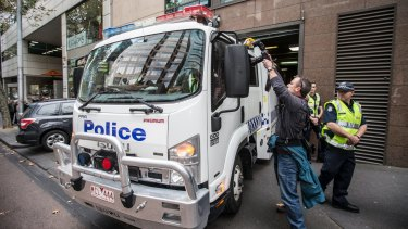 A police van carrying five alleged terror suspects arrives at the Melbourne Magistrates Court on Thursday