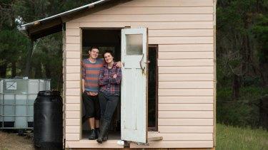 Rachel Newby and Liam Culbertsonin the doorway of their shack.