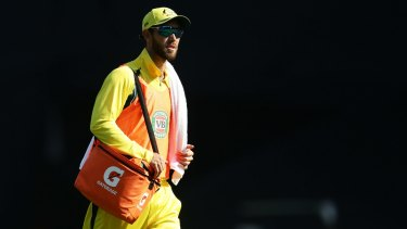 Influential: Glenn Maxwell carries the drinks at the SCG on Sunday.