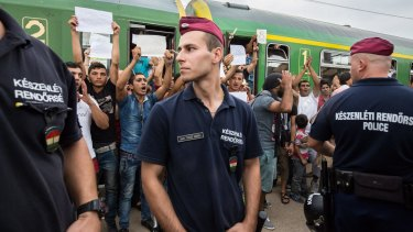 Refugees protest against being taken to a camp from a train at Bicske station on Thursday.