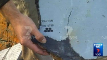 "The small piece of debris has a honeycomb symbol and the words ""Caution no step""."