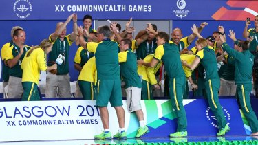 The Australian team give the relay squad a guard of honour.