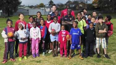 Inspiration: Swans player Aliir Aliir charms the mostly Burmese, Afghan and African youngsters at the multicultural camp in Wagga Wagga.