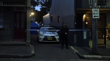 Police at one of the raided premises in Surry Hills.
