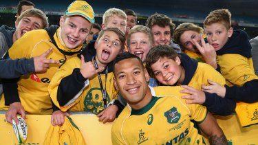 Folau poses with Wallaby fans in 2015.