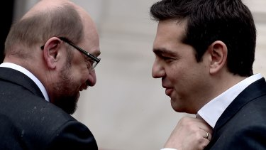 Greek Prime Minister Alexis Tsipras gets his collar waggled by European Parliament Chairman Martin Schulz before their meeting in Athens.