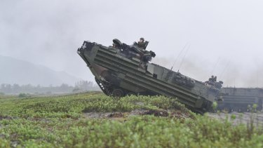 US marines amphibious assault vehicles land on a beach during military exercises with their Philippine marine counterparts in October. Rodrigo Duterte ordered a halt to any joint patrols and naval exercises between the US and the Philippines military including patrols at the disputed South China Sea.