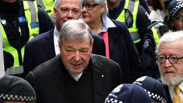 George Pell leaves the Magistrates Court on Friday.