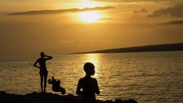 Hot times: People watching a sunset at La Boca beach in Sancti Spiritus, Cuba.