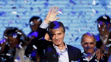 Mauricio Macri, Buenos Aires' Mayor and presidential candidate, waves to supporters in Buenos Aires on Sunday.