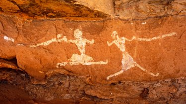 Running figures painted onto the walls of Uan Muhuggiag, one of Wadi Teshuinat's caves.