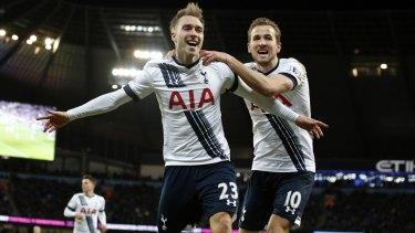 Tottenham's Christian Eriksen, left, celebrates  with Harry Kane after scoring his side's winner.
