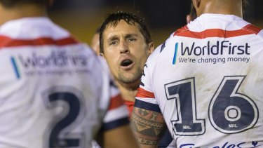 Tense moments: Mitchell Pearce directs his team as the match goes to the wire.