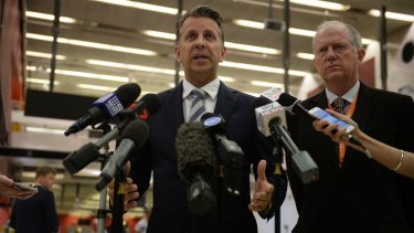 Transport Minister Andrew Constance, left, and Sydney Trains chief executive Howard Collins address the media on Wednesday.