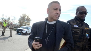 Juan Carlos Mendez gathers a group of pastors from area churches for a prayer vigil on Thursday in San Bernardino.