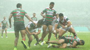 Torrential rain meant the match between Souths and the Dragons was tight and forward-driven.