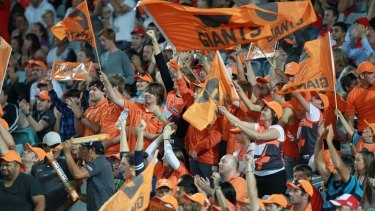 Growing force: GWS Giants fans at ANZ Stadium, Sydney, react after the team scores a goal.