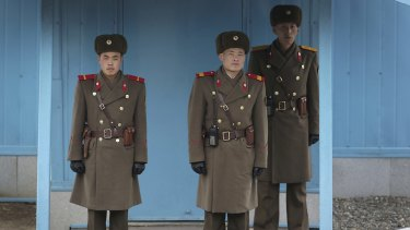 North Korean soldiers guard the truce village of Panmunjom at the Demilitarized Zone (DMZ) which separates the two Koreas.