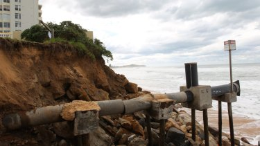 A sewerage pipe is exposed in storms at South Narrabeen.