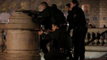 Police react to suspicious behaviour at Place de la Republique in Paris on Sunday.